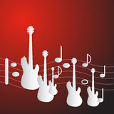 Abstract Red Music Background. Guitars and Staff Made from Paper Royalty Free Stock Image