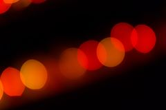 Abstract red and orange circular lined bokeh. Background of Christmas light Royalty Free Stock Images