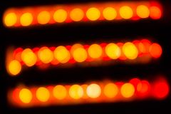 Abstract red and orange circular lines bokeh. Background of Christmas light Royalty Free Stock Images