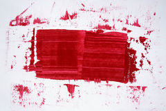 Abstract red paint on white background. Art is painted by photographer Royalty Free Stock Photos