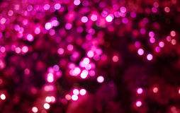 Abstract red and pink circular bokeh background Stock Images
