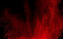 Abstract red powder explosion on black background.abstract red powder splatted on black background. Freeze motion of red powder ex. Ploding stock photo