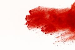 Abstract red powder explosion on white background. abstract red dust splatted on white background, Freeze motion of red powder exp. Loding royalty free stock images