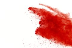 Abstract red powder explosion on white background. abstract red dust splatted on white background, Freeze motion of red powder exp. Loding stock photos