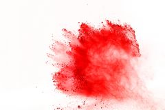 Abstract of red powder explosion on white background. Red powder splatted isolate. Colored cloud. Colored dust explode. Paint Holi.  stock image