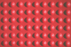 Abstract red rubber  bumpy surface Stock Images