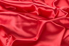 Abstract red satin fabric background Royalty Free Stock Photography
