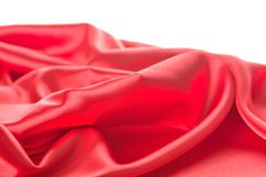 Abstract red satin fabric background Stock Images