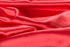 Abstract red satin fabric background. Abstract red satin fabric close up background Stock Images