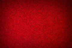 Abstract red textured background. Texture of the pile fabric closeup. Can be used for decoration of Christmas, Valentine's day Royalty Free Stock Images