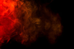 Abstract red and yellow smoke hookah on a black background.