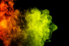 Abstract red and yellow smoke hookah on a black background. Stock Photos