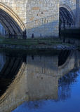 Abstract reflection of stone bridge in river Royalty Free Stock Photography