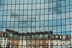 Abstract reflexion. Modern building with reflexion from old building Royalty Free Stock Photos