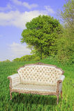 Abstract regency chaise in field Royalty Free Stock Photos