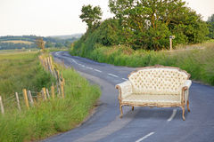 Abstract regency chaise in middle of road Royalty Free Stock Photo