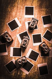 Abstract retro camera background. Photographic nostalgia in the taking with a bunch of old vintage camera toys surrounded by a abstract vintage photo collection Royalty Free Stock Image