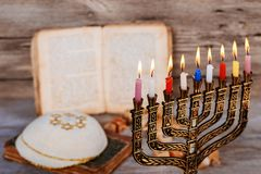 Abstract retro filtered low key image of jewish holiday Hanukkah with menorah traditional Candelabra. With glitter overlay Royalty Free Stock Photo