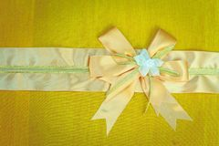 Abstract ribbon bow on fabric. Stock Photo