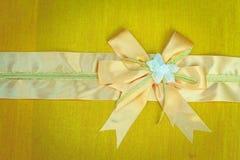 Abstract ribbon bow on fabric. Stock Photo