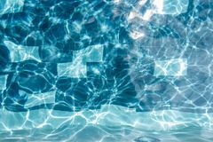 Abstract ripple swimming pool water and sun reflection. For web and print royalty free stock photo