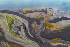 Abstract river mouth. Aerial image of a river flowing through a beach on low tide Stock Photography