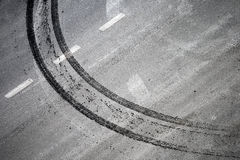 Abstract road background. With crossing of road marking and tires track Royalty Free Stock Images