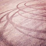 Abstract road background with tire tracks on the asphalt - vintage effect. Royalty Free Stock Images
