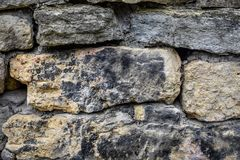 Abstract Rock Wall Background Black and Yellow stock photography