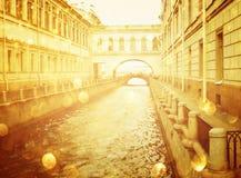 Abstract romantic cityscape view with golden bokeh light burst Stock Photos