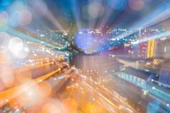 Abstract rondschrijven van Lichte auto's bokeh in stad bij nacht Stock Foto