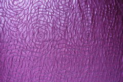 Abstract roses pattern on violet fabric from above Stock Photos