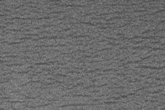 Abstract rough gray surface background. Similar to asphalt, concrete, plastic. Gray matte texture of the cells. Abstract rough gray surface background. Similar royalty free stock images