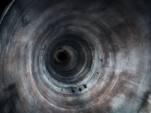 Abstract round grunge tube or pipe inside view with perspective and motion effect, empty sewer tunnel with dark in end royalty free stock image