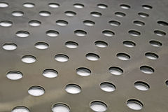 Abstract round holes on metal surface, industry, Royalty Free Stock Photos