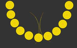 Abstract round yellow beads. Jewelry on chest isolate dark gray background Stock Photography