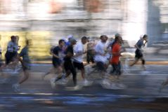 Abstract runners. Effect abstract runners moving in the city Royalty Free Stock Image