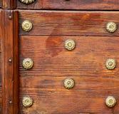 Abstract  rusty brass brown knocker door crenna gallarate  italy. Abstract  rusty brass brown knocker in a   closed wood door crenna gallarate varese italy Stock Image