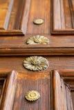 Abstract  rusty brass brown knocker gallarate varese. Abstract  rusty brass brown knocker in a   closed wood door crenna gallarate varese italy Stock Images