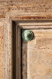 abstract   rusty brass    door curch  closed wood    varese lona Stock Photography