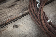 Abstract Rusty Iron Cable Laying on Old Wood Planks Royalty Free Stock Photos