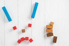 Abstract sad face with colorful wooden blocks with thumb down. The concept of bad mood stock photos