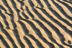 Abstract sand ridges. Ridges in the sand next to the ocean stock photos