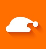 Abstract Santa Claus hat on orange background Stock Photos