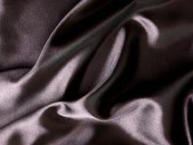Abstract satin. Closeup of shiny black silk Royalty Free Stock Photo