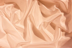 Abstract satin background. Colored with light pink Stock Image
