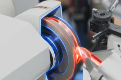 The abstract scene Drill grinding machine. With glowing edge lighting effect stock image