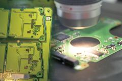 The abstract scene of the electronics circuit board . The abstract scene of the electronics circuit board with the telescopic camera for quality control stock photo