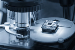 Abstract scene of microscope and the microchip. Stock Photo