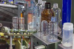Abstract scene  of plastic bottle manufacturing. Process Stock Images